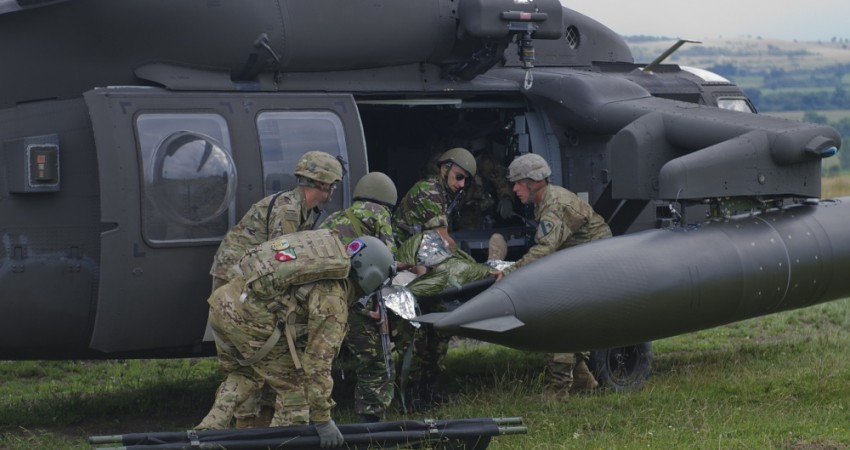 Photo By Sgt. Justin Geiger | U.S. and Romanian Soldiers transfer the simulated casualty to a UH-60 Black Hawk to air lift the Soldier to a local medical treatment facility in Romania at the Joint National Training Center in Cincu, July 8, 2017. Getica Saber 17 is a U.S-led fire coordination exercise and combined arms live fire exercise that incorporates six Allied and partner nations with more than 4,000 Soldiers. Getica Saber runs concurrent with Saber Guardian, a U.S. Army Europe-led, multinational exercise that spans across Bulgaria, Hungary and Romania with more than 25,000 service members from 22 Allied and partner nations. (U.S. Army photo by Sgt. Justin Geiger)