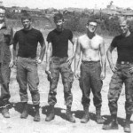 """""""Albert"""" Gambrell, Dale Markovich, Doc Gilchrest, D.B. Brown and Roy Olson. The black T-shirts were a trademark of the team. Probably at Phan Thiet."""