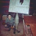 Glen McCrary with a captured 75mm round and 7.62mm light machine gun.